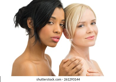 Closeup of beautiful african and caucasian women looking at camera isolated on white background