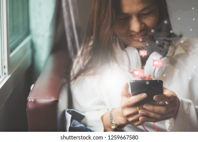 closeup of beautiful Asia woman,girl using smartphone,mobile phone working,playing with fun and happy in free time on holiday.
