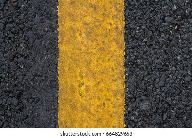 Closeup and beautiful an asphalt road texture background patterns with yellow painted line on the side for design and decorative workings, Close up tar road for using the vehicle