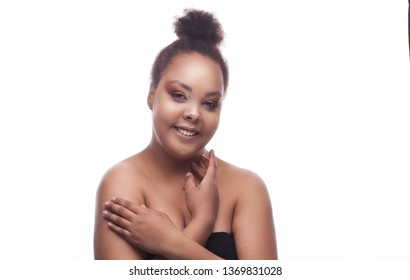close-up Beautiful black african woman face studio portrait. day makeup. isolated on the white.