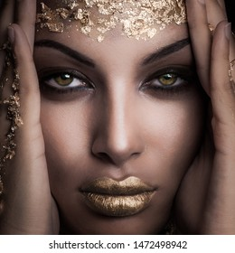 closeup of beautiful black girl with golden makeup