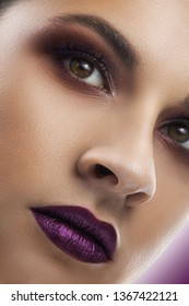close-up Beautiful blonde woman face studio. evening makeup, purple lipstick. close-up portrait