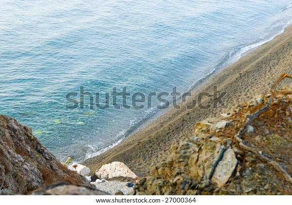 Close-up with beautiful blue sea under rocks