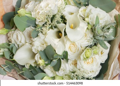 close-up beautiful bouquet made of different flowers. colorful color mix flower on a table covered with cloth