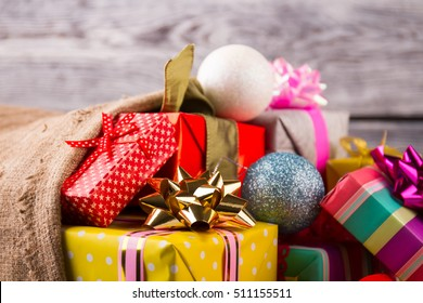 Close-up of beautiful Christmas gifts. Christmas surprises. Gifts with Christmas balls.