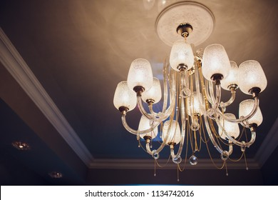 Close-up of a beautiful crystal chandelier Beautiful chandelier. luxury expensive chandelier hanging under ceiling