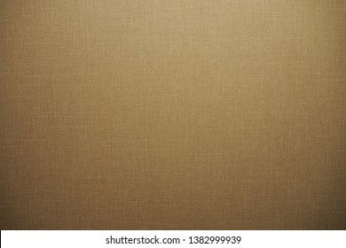 Closeup of beautiful fabric texture in dark warm brown and golden tone for luxury background and wallpaper. Cool banner on page, cover, presentation and website
