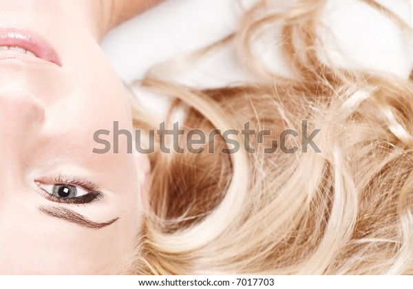 Close-up of beautiful face with flowers. On white background