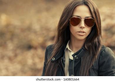 Closeup of a beautiful fashion woman in sunglasses