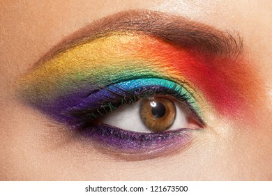 closeup of beautiful female eye with rainbow makeup