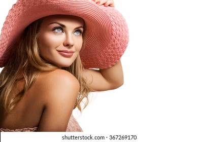 Close-up Beautiful Female Face in a Hat. Beautiful and Happy Girl in Pink Hat on his Head. Isolated on white background. Woman and Sun, Pretty Woman Background  White