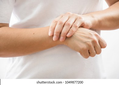 Closeup Of Beautiful Female Hands Hurt. Close-up Of Woman's Hands .With Painful Feeling In Joint. Hand Injury And Health Issues Concept.Hand Pain