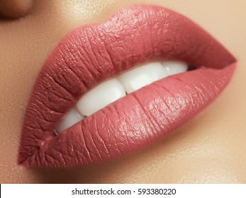 Close-up beautiful female lips with bright lipgloss makeup. Perfect clean skin, light fresh lip make-up