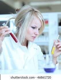 Closeup of a beautiful female researcher carrying out an experiment in a lab (color toned image)