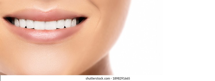 Closeup of beautiful female smile with a white teeth