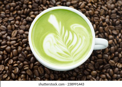 Closeup of a beautiful green tea on coffee bean background