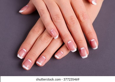 Close-up of a beautiful lunar french manicure.