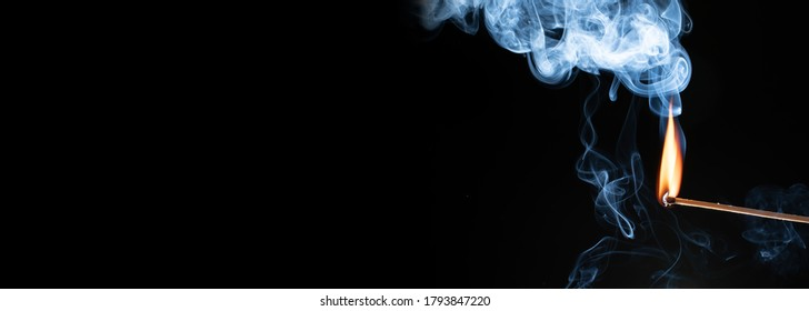 close-up of a beautiful matchstick light isolated on black background, cut out texture or template