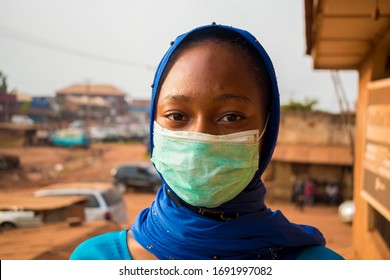 closeup of a beautiful muslim lady wearing hijab using face mask to prevent, preventing, prevented herself from the outbreak in the society.