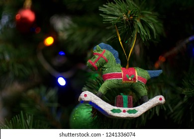 closeup of beautiful new-year tree toy, a hobbyhorse. background