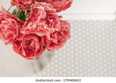 Closeup of beautiful pink peony tulip flowers bouquet in on marble table and mosaic tile
