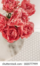 Closeup of beautiful pink peony tulip flowers bouquet in on mosaic tile