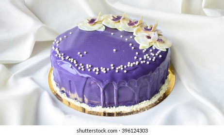 Closeup of beautiful purple cake with orchid flowers