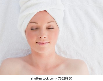 Closeup of a beautiful serene woman posing while relaxing in a spa