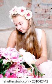 Close-up of Beautiful teenager girl looking at bouquet of flowers