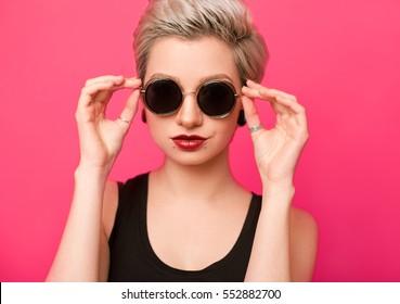 closeup beautiful trendy hipster girl in retro sunglasses
