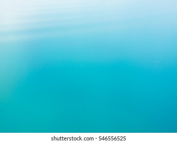 Closeup of Beautiful Turquoise Blue Lake Surface as Background