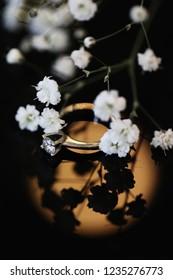Closeup Beautiful Wedding Ring under gypsophilias