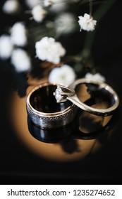 Closeup Beautiful Wedding Rings near gypsophilias