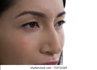 Close-up of beautiful woman against white background