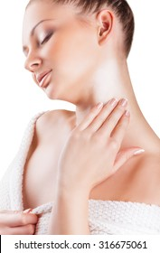 Close-up of a beautiful woman applying moisturizer cosmetic cream on neck isolated on white background