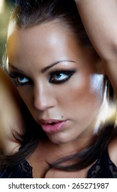 Closeup of a beautiful woman with confident look. Slight grain.