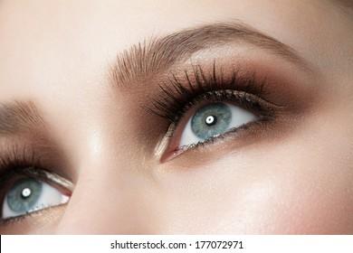 Closeup of beautiful woman eye with bright stylish makeup