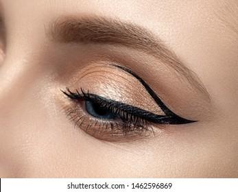 Closeup of beautiful woman eye with fashion makeup