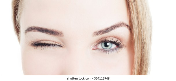 Close-up with beautiful woman eyes and wink isolated on white