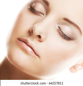 Close-up of beautiful woman face. On white background