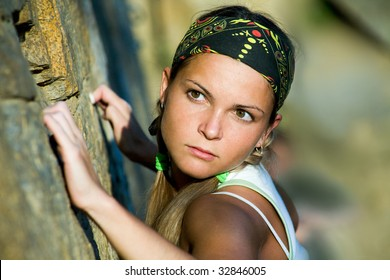 Close-up of beautiful woman holding the rock