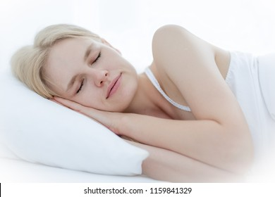 Closeup of a beautiful woman sleeping in bed.