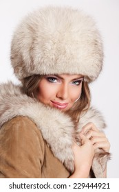 Closeup of a beautiful woman at winter on white background