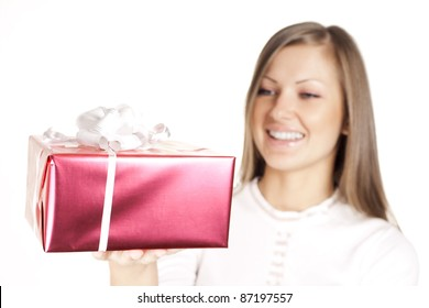 closeup of a beautiful young smiling woman holding christmas gift