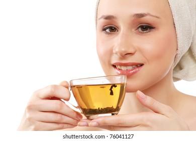 Closeup of a beautiful young woman enjoying tea