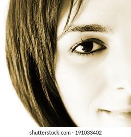 Closeup of beautiful young woman face.