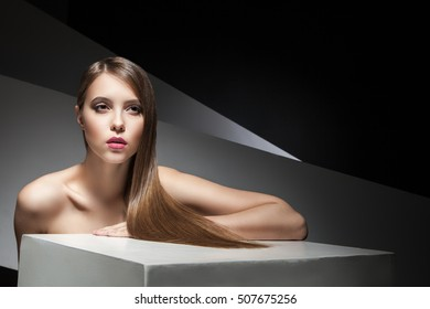 Close-up of beautiful young woman with shining hair