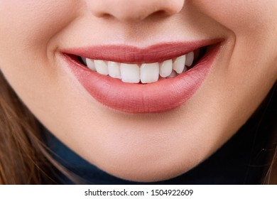 Closeup Beautiful young woman smile. Dental health. Teeth whitening.  Restoration concept