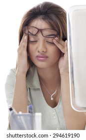 Close-up of beautiful young woman suffering from headache