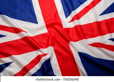 Closeup beautifully wavingof UK British flag Union Jack flag background